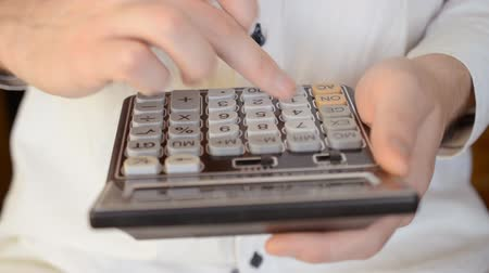 Closeup male hand working on calculator, financial concept Stock Footage