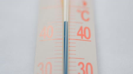 The thermometer blue scale close-up on white background