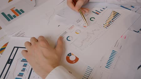 Closeup of female hands working with documents, charts report indoors chek Stock Footage