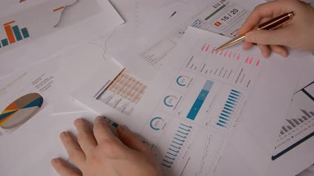 metodo : Trader Man hands Working With Documents And Financial Report, srock market concept hd stock footage Filmati Stock