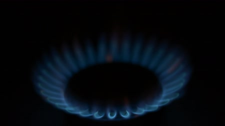 Gas burner on black background soft focus