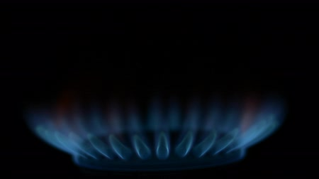 gyújtás : Gas burner with burning blue flame on black background soft focus hd footage