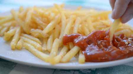 fry : golden yummy French fries on plate front view Stock Footage