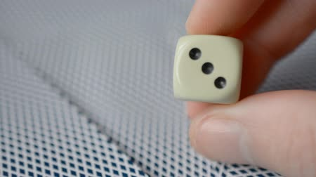 kasyno : Hand Holding Dice close-up hd stock footage