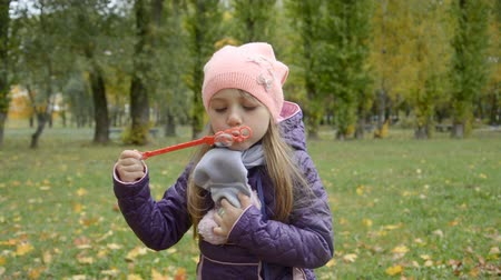 eight : Little girl blowing soap bubbles hd stock footage