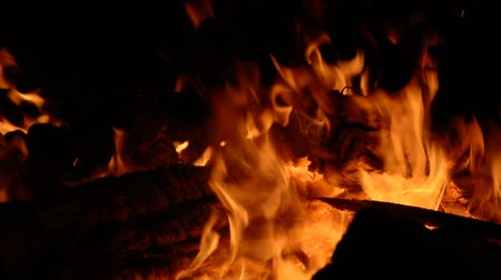 Close-up shot of warm cozy burning fire at dark hd stock footage