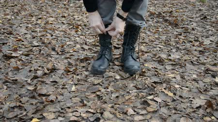 buty : Military man in uniform tying brown shoelaces on military boots hd stock footage