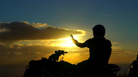 rapa : Man on ATV with the Sunset behind Easter Island Chile