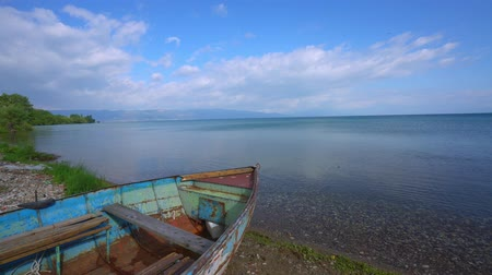 blue color : Lake Ohrid landscapes and Boat washed on beach