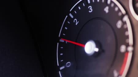 urychlit : Color close up footage of a cars tachometer idling.