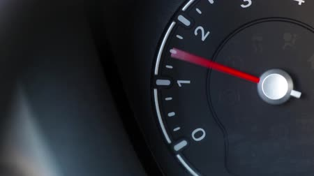 rpm : Color close up footage of a cars tachometer revving.