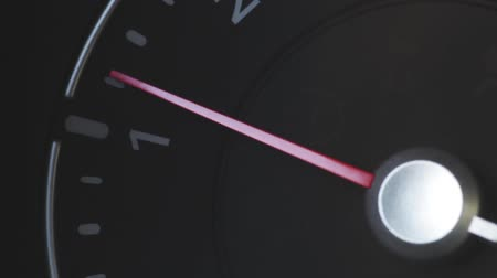 rpm : Color close up footage of a cars tachometer idling.
