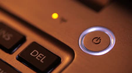 кнопка : Close up panning footage of a laptop power button.