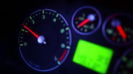 rpm : Color close up footage of a cars tachometer moving.