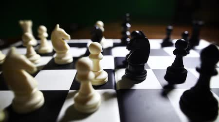 war field : Dolly pull shot of the white and black pieces on a chess board, with shallow depth of field. Stock Footage