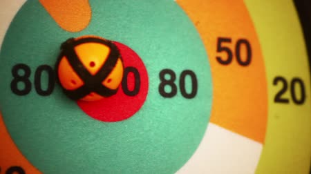 unlucky : Close up hot of a target with a ball being thrown and hitting the center spot. Stock Footage