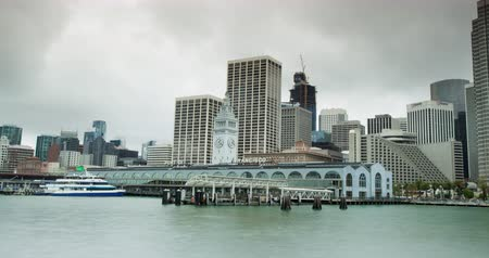 greater : San Francisco Ferry Building. Waterfront view of the Ferry hub in downtown San Francisco. It also hosts high end restaurants and food merchants and serves as a Farmer Market twice a week. Stock Footage