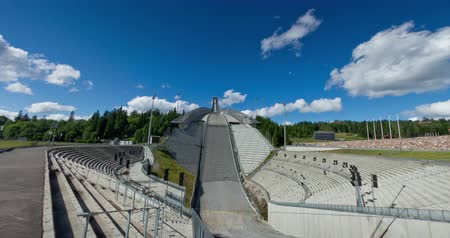 Holmenkollen ski jump. Rolling cumulus clouds at Holmenkollen Ski Park during the Summer. Stock Footage