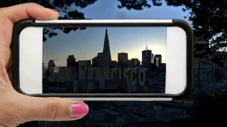 photography themes : Mobile Phone Photographing downtown San Francisco.