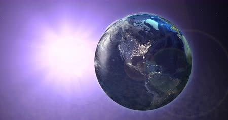 fenomen : Rotating Earth with the sun in the background. Purple Hue.