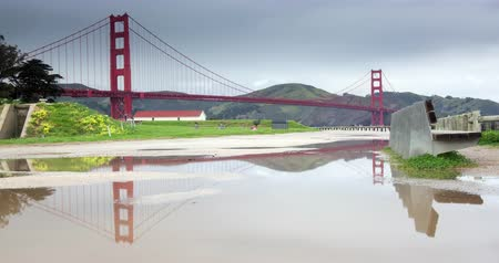 Golden Gate Bridge with Rain Puddle Reflection