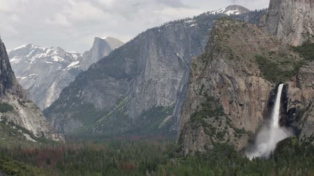 Yosemite Valley with Bridal Veil Falls at Max Flow During Heavy Spring Snow Melt. Audio sound of the rumbling waterfall.