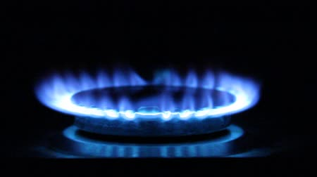 the inflammation : Blue flames. Flames on a gas ring burner of a natural gas cooker Stock Footage