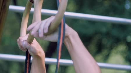 megragad : Close - up on the Playground mens hands grab the gymnastic ring Stock mozgókép
