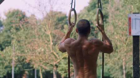 cross training : Athlete trains on the rings