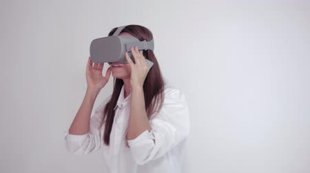 Woman uses a virtual reality glasses