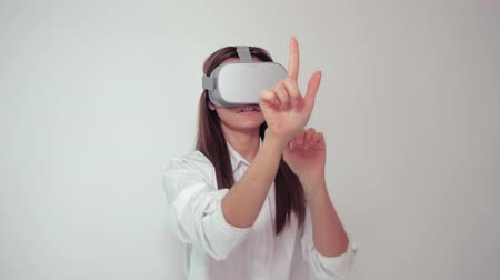 Young hip woman wearing VR 360 goggles pressing objects