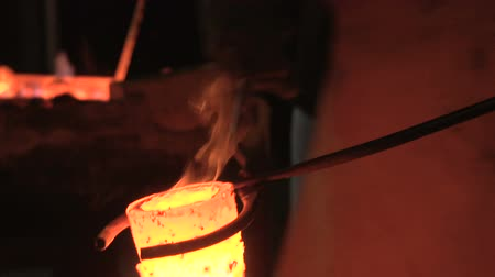 smithy : Pouring of liquefied bronze in a gypsum cast in the night 4 Stock Footage