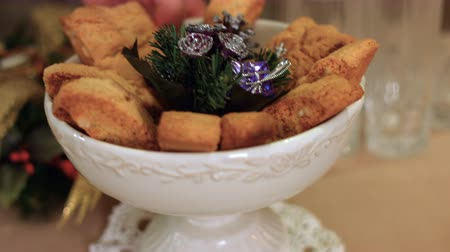 Christmas cakes and cookies served on a shining and warmth table k33 SF Archivo de Video