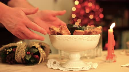 дымоход : Italian Christmas cookies with hazelnuts are served on a shine and warmth table k39 SF Стоковые видеозаписи