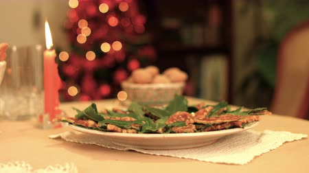 Italian Christmas cakes with honey and laurel leaves served on a shine and warmth table. k47 SF