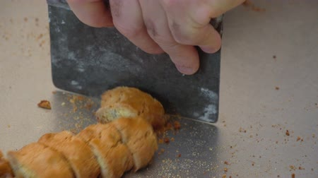 An italian pastry chef is cutting bakery traditional hazelnuts cookies. 25 SF Vidéos Libres De Droits