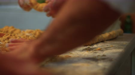 rodzynki : An italian pastry chef is Kneading traditional cookies with hazelnuts 4k6 FDV Wideo