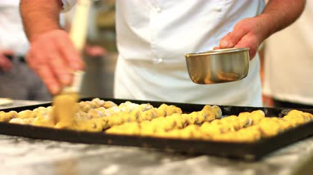 An italian pastry chef is Preparing cakes and pastries with chocolate, hazelnuts and honey 7 FDV