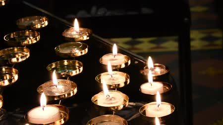 modlitba : Prayer candles, or Votive candles in a church.