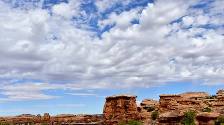 Timelapse of stratus clouds, Canyonlands National Park, Utah. Camera panning left to right. Cloud movement also left to right. Stock Footage