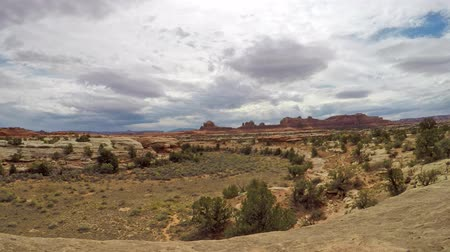 Timelapse of stratus clouds at Canyonlands National Park near Wooden Shoe Arch, Needles District, Utah. Camera is panning left to right. Clouds are moving right to left.