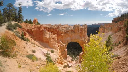 erozyon : Natural Bridge at Bryce Canyon National Park. Camera panning lower right to upper left.