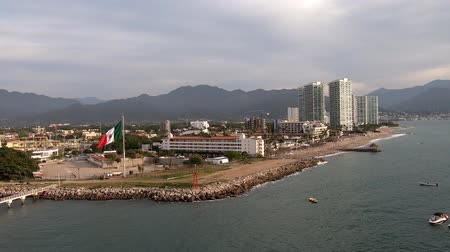 mexico city : Puerto Vallarta as seen from cruise ship leaving the harbor. Camera steady, but moving from left to right. Stock Footage
