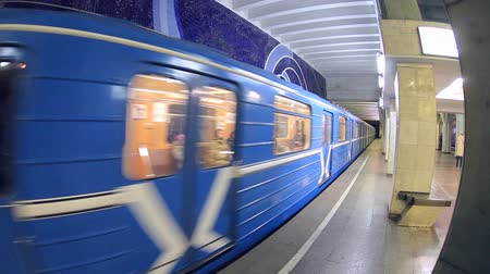approaching subway : Blue subway train in motion at the station