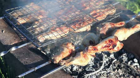 porky : Chicken meat pieces being fried on a charcoal grill at the outdoors