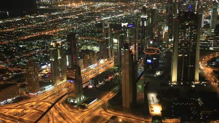 DUBAI, UAE - NOVEMBER 13: Aerial view of Downtown Dubai with man made lake and skyscrapers from the tallest building in the world, Burj Khalifa, at 828m, taken on 13 November 2012 in Dubai. Dostupné videozáznamy
