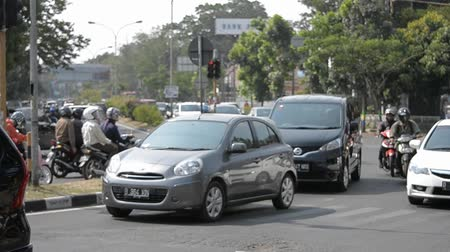 indonesia : Bandung, Indonesia - November 2, 2014: Scenery of busy traffic in Bandung city, West Java-Indonesia.