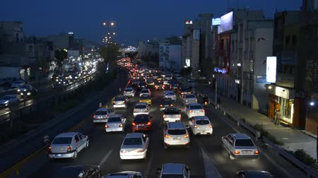 autobahn : Tehran, IRAN - March 15, 2018 moving vehicles on Resalat highway at dusk time, cars moving slowly at evening traffic Stock Footage
