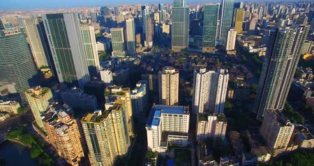 cbd : Aerial view of Chengdu City in the morning sunlight, dense residential building near the office building under the blue sky, the Taikoo Li Mall area with traditional Asian style building. Stock Footage
