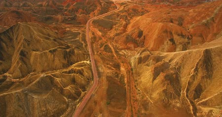 geológiai : Aerial view of winding road in the middle of colorful rock formations of The Zhangye National Geopark in Gansu province of China